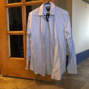 White and light blue Men's Dress shirts.